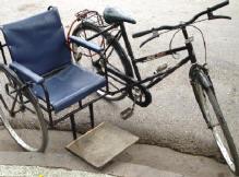 rolstoel met fiets